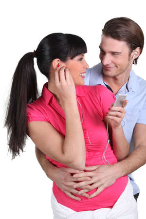 Cheerful woman and man with mp3 player photo