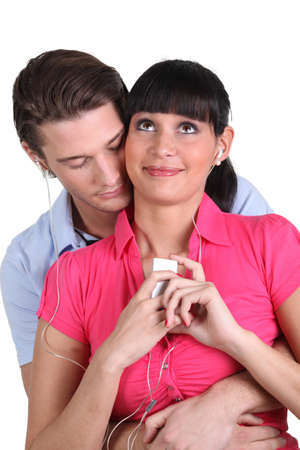 Young couple listening to an MP3 player photo