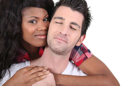 happy couple white background: Portrait of an interracial couple