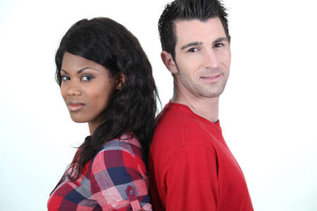interracial marriage: Couple standing back to back