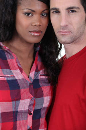 Serious mixed race couple photo