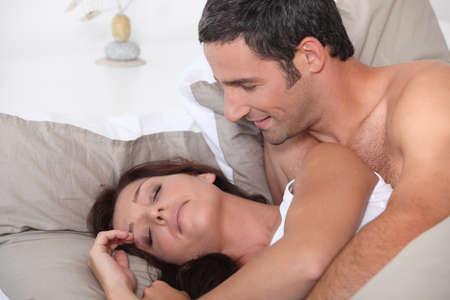 cranky: Man waking up his cranky wife