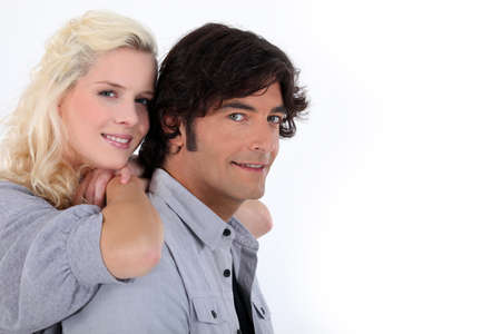 Couple stood together on white background photo