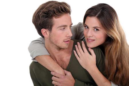 man woman hugging: Woman surprising man