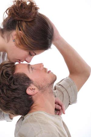 beard woman: Woman kissing man on the forehead