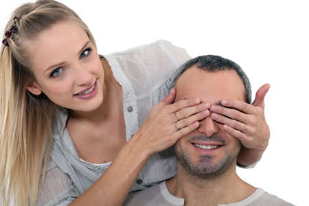 peek a boo: Woman covering a man