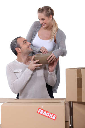 couple arranging their new apartment Stock Photo - 16411418