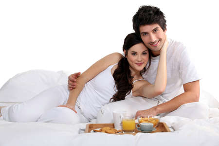 taking a wife: a couple having breakfast on bed Stock Photo