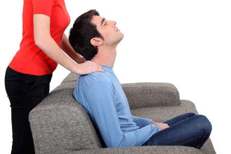 unwinding: Woman giving husband neck massage
