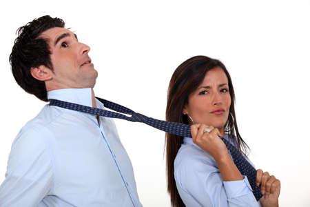 pulling beautiful: Woman pulling on boyfriend Stock Photo