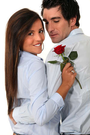 giving back: Couple with a red rose