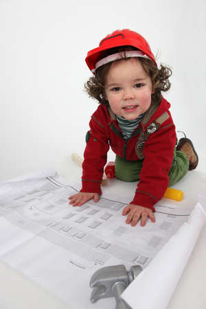 Young child pretending to be a construction worker photo