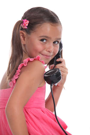ancient telephone: Girl with old telephone handset
