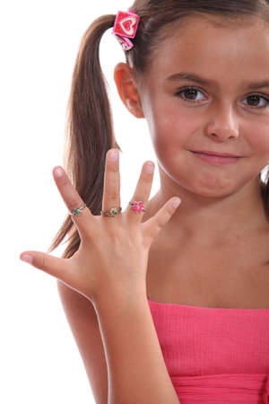 cute little girl showing the rings on her hand photo