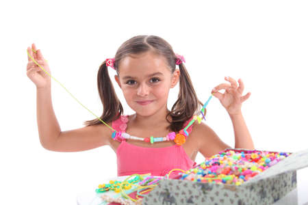 christmas beads: Little girl with necklace