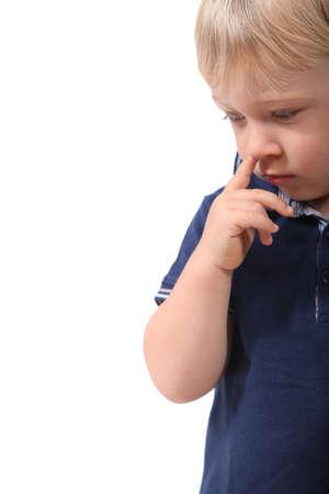 nose picking: Little boy picking his nose