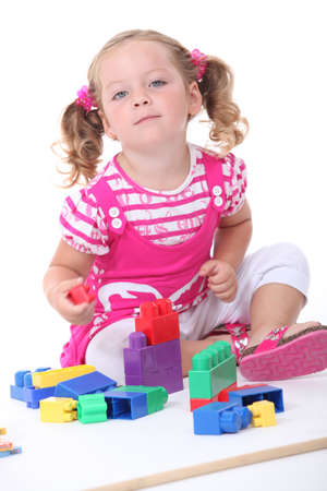 insightful: Girl with construction game Stock Photo