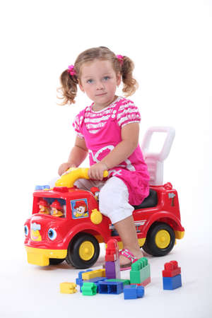 baby open present: Girl with a toy fire engine