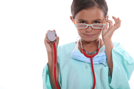 grown up: Child wearing grown up hospital scrubs, glasses and a stethoscope