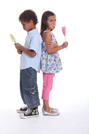 insipid: a little boy and a little girl pouting and eating ice cream