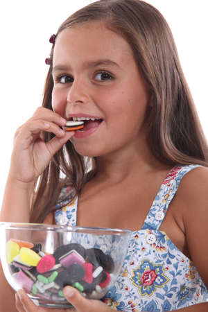 Girl eating sweets photo