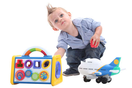 12 18 months: Young boy playing with toys in a studio Stock Photo