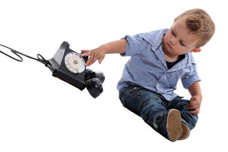 telephone receiver: Child playing with a telephone Stock Photo