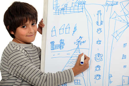 6 7 year old: Boy drawing on a whiteboard