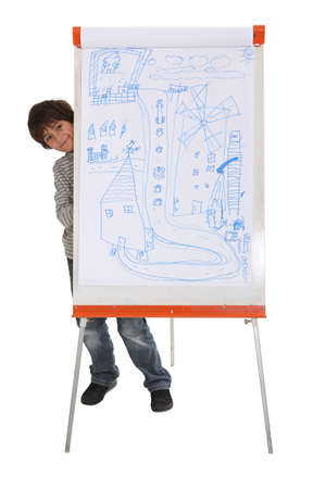 Child hiding behind a flip chart Stock Photo - 16411444