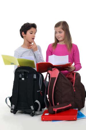Schoolchildren comparing homework