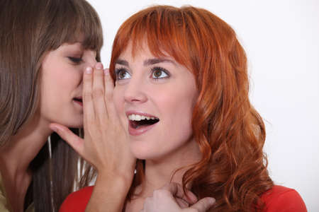 anecdote: Woman whispering into another woman