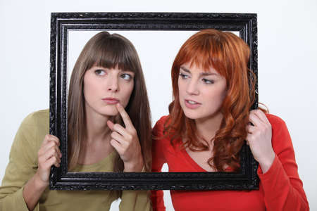 confide: girls behind a wooden frame