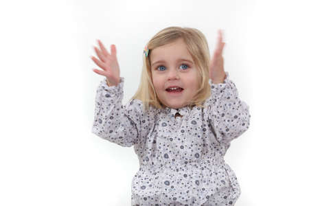 Little girl clapping Stock Photo - 16411515