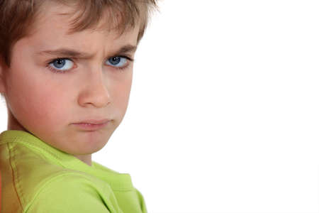 expressive mood: little boy sulking Stock Photo