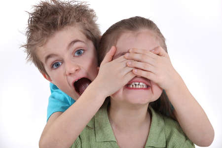 Children playing peek-a-boo photo