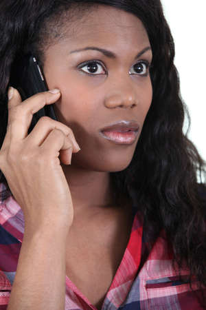flat nose: African woman with mobile phone