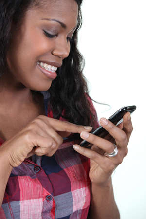 Smiling woman with a touch sensitive phone photo