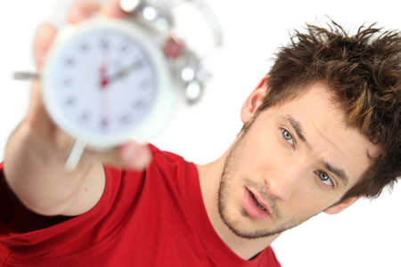 frazzled: A frazzled man holding an alarm clock