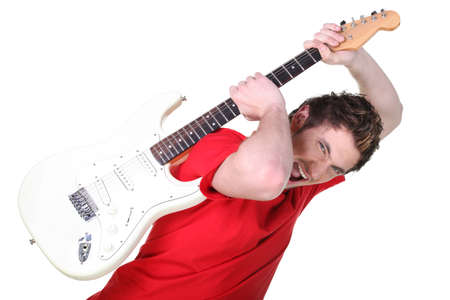 inlays: Aggressive young man about to smash his guitar