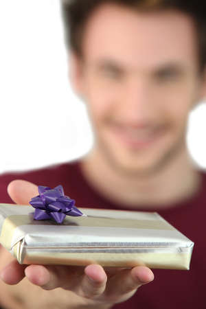 Man holding out a mystery gift photo