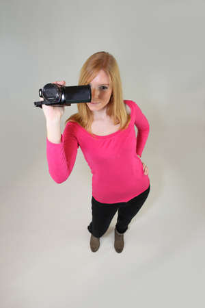 Young woman holding a video camera Stock fotó