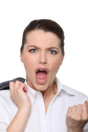 clenching: Businesswoman clenching fist