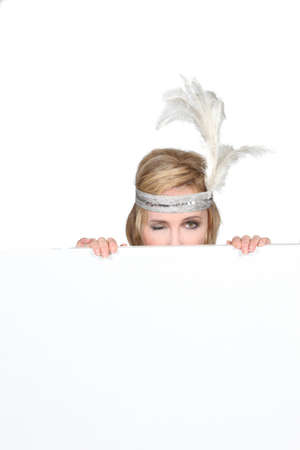 innuendo: Woman winking with feathers Stock Photo