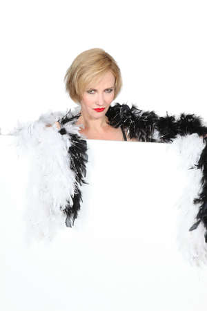 Woman with a feather boa photo