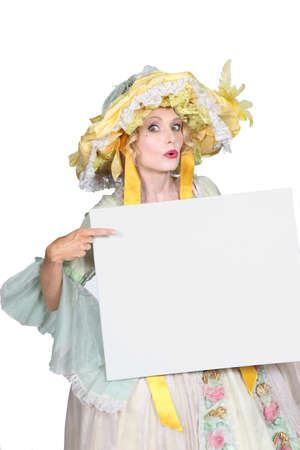 out dated: Woman in disguise pointing to blank message board