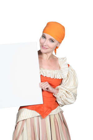 wench: Woman in a theatrical outfit and a board blank for your message