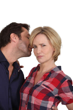 innuendo: Man whispering a secret to his partner