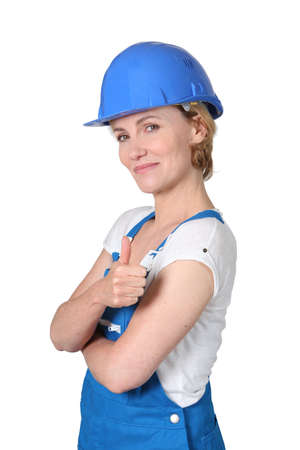 thumbsup: Female builder giving thumbs-up