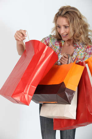 delighted: Woman delighted with purchases