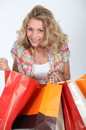 Woman looking in shopping bags photo